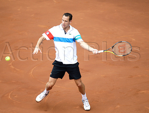 06.05.2011 Madrid, Spain.   Michael Llodra (FRA) in action against  Rafael Nadal (ESP), Quarter-final of the Mutua Madrilena Madrid Open, Spain.....