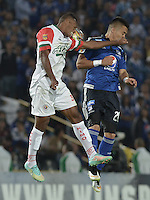 BOGOTA - COLOMBIA -21 -02-2015: Fernando Uribe (Der) jugador de Millonarios disputa el balón con Edwin Velasco (Izq) jugador de Cortulua FC durante partido por la fecha 5 de la Liga Águila I 2015 jugado en el estadio Nemesio Camacho El Campín de la ciudad de Bogotá./ Fernando Uribe (R) player of Millonarios fights for the ball with Edwin Velasco (L) player of Cortulua FC during the match for the 5th date of the Aguila League I 2015 played at Nemesio Camacho El Campin stadium in Bogotá city. Photo: VizzorImage / Gabriel Aponte / Staff.