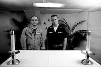 Chaplain Muehler on right and Chaplain Stanfield, two of the three chaplains on board  the USS Dwight D. Eisenhower (CVN 69), in the ship's chapel on Monday June 1 2009 at an undisclosed location in the Arabian Sea. .The ship is a nuclear powered american aircraft carrier that is currently supporting Operation Enduring Freedom, the american effort in Afghanistan, by sending tens of its jets every day to support ground troups in air to ground bombing operations.