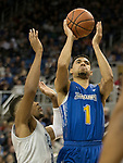 South Dakota State guard Skyler Flatten (1) shoots against Nevada in the second half of an NCAA college basketball game in Reno, Nev., Saturday, Dec. 15, 2018. (AP Photo/Tom R. Smedes)