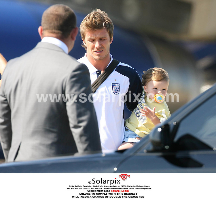 ALL ROUND PICTURES FROM SOLARPIX.COM. .The England Team arrive at Stansted Airport on 02.07.06 after their exit from the 2006 World Cup. Job Ref: 2533/EBR..This pic: David and Cruz Beckham.MUST CREDIT SOLARPIX.COM OR DOUBLE FEE WILL BE CHARGED..