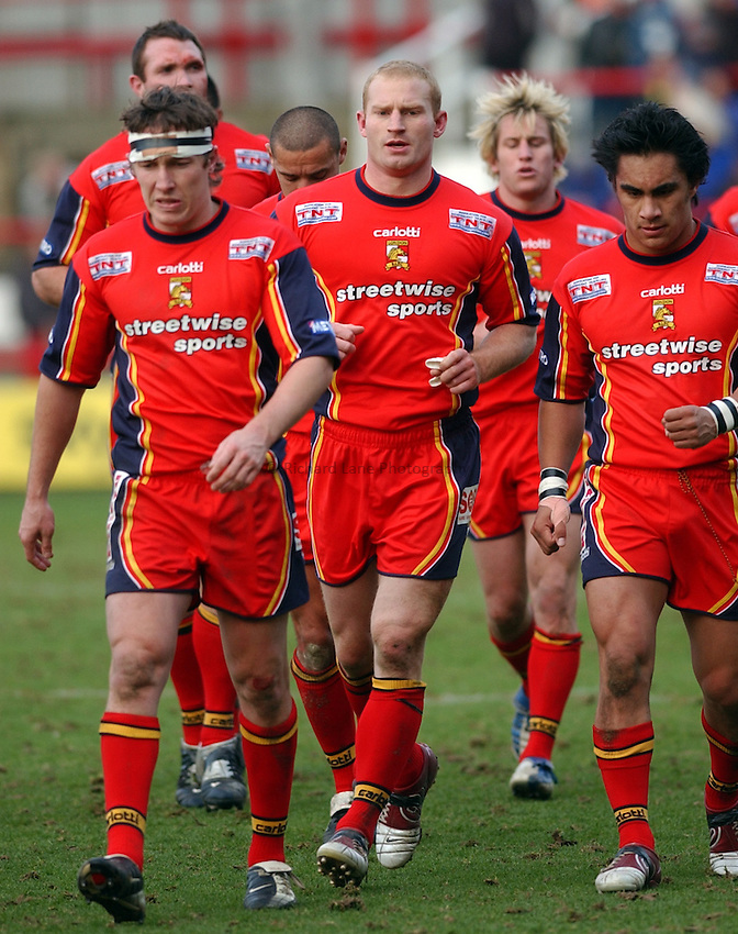 Photo: Daniel Hambury..London Broncos V Warrington Wolves..Tetleys Super League..13/02/2005..Broncos'Jon Wells leads the team out for the second half.