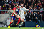 Diego Roberto Godin Leal (l) of Atletico de Madrid competes for the ball with Karim Benzema of Real Madrid during the La Liga 2017-18 match between Atletico de Madrid and Real Madrid at Wanda Metropolitano  on November 18 2017 in Madrid, Spain. Photo by Diego Gonzalez / Power Sport Images