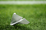 A paper aeroplane thrown by fans is seen stuck in the surface of the pitch during the Coppa Italia match at Giuseppe Meazza, Milan. Picture date: 12th February 2020. Picture credit should read: Jonathan Moscrop/Sportimage