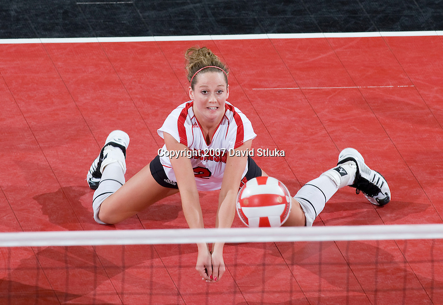 MADISON, WI - NOVEMBER 9: Kim Kuzma #2 of the Wisconsin Badgers volleyball team hits the ball against the Michigan Wolverines at the Field House on November 9, 2007 in Madison, Wisconsin. The Badgers beat the Wolverines 3-2. (Photo by David Stluka)