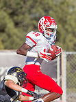 Palos Verdes, CA 10/24/14 - Warren Jackson (Redondo Union #18) and Andrew Phillips (Peninsula #16)in action during the Redondo Union - Palos Verdes Peninsula CIF Varsity football game at Peninsula High School.
