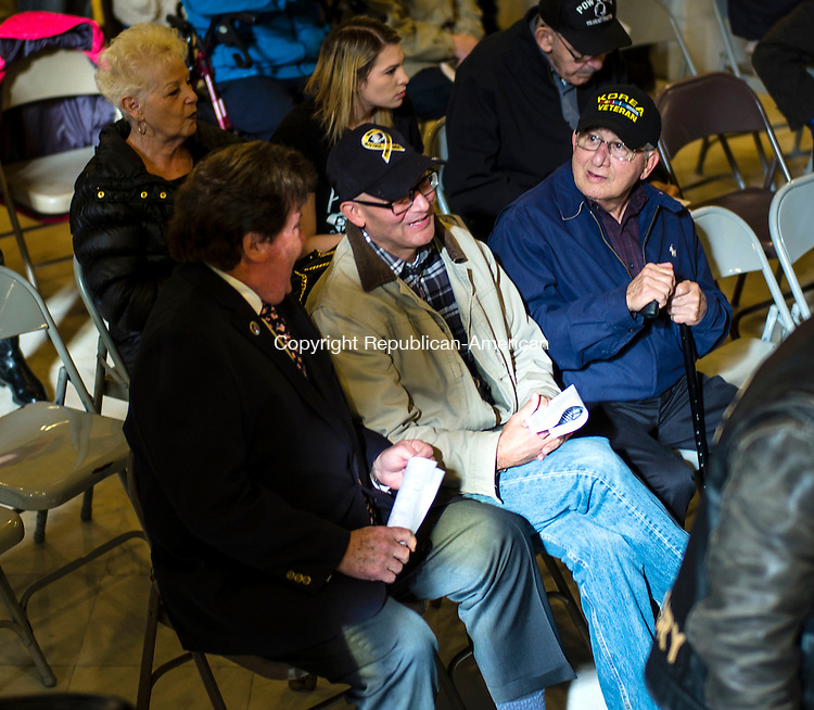 Waterbury, CT- 11 November 2016-111116CM02- From left, Michael Dalton, a Vietnam War Veteran who served with the U.S. Army, Chris Ursini, and his father, Dante Ursini a Korean War Veteran who served with the U.S. Army chat before a Veterans Day ceremony at Waterbury City Hall on Friday.     Christopher Massa Republican-American