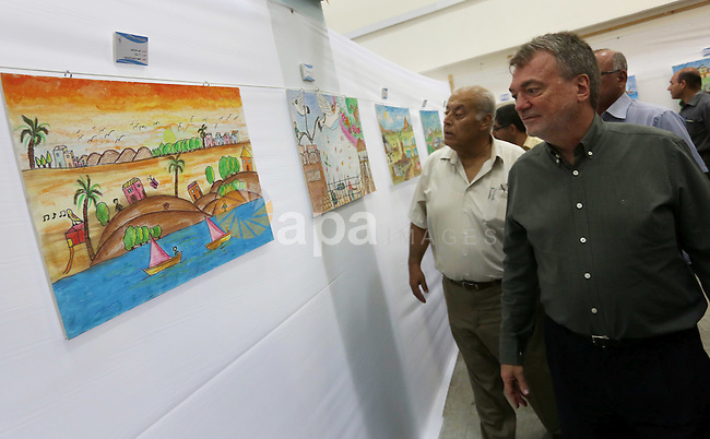 """Director of UNRWA operations in Gaza Bo Shack attends the art exhibition """"draw your dream for Gaza 2020"""", in Gaza city on Aug. 23, 2016. Photo by Mohammed Asad"""