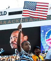 8/28/08 5:05:01 PM -- Denver, CO, U.S.A. -- Democratic National Convention Day four at Invesco Field -- ..John Priddy, of Denver, CO, waves a flag during a video honoring Martin Luther King Jr. during the DNC Thursday at Invesco Field at Mile High. ..Photo by Pat Shannahan, USA TODAY staff.
