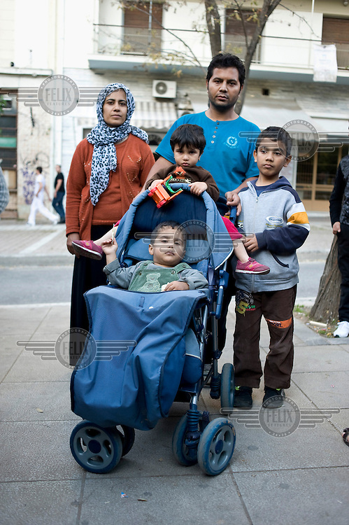 An Afghan refugee family on Victoria Square in Athens. According to UNHCR, 38,992 immigrants arrived in Greece in the first 10 months of 2010, whereas in 2009 the number was only 7,574.