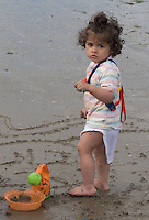 Safina beside Morgan who's digging the sand filling a bucket Bettystown beach 2nd Aug 2007