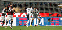 Calcio, Serie A: Milan vs Juventus. Milano, stadio San Siro, 9 aprile 2016. <br /> Juventus&rsquo; Mario Mandzukic, second from right, prepares to kick to score during the Italian Serie A football match between AC Milan and Juventus at Milan's San Siro stadium, 9 April 2016.<br /> UPDATE IMAGES PRESS/Isabella Bonotto