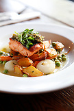 USA, California, Oakland, Chop Bar, Local King Salmon, English Peas, baby carrots, crispy potatoes, cipollini onions, salmon fumet, pea shoot salsa verde