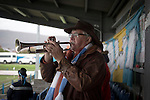 A home supporters blows his own trumpet as Port Talbot Town play host to Caerau Ely in a Welsh Cup fourth round tie at the Genquip Stadium, formerly known as Victoria Road. Formed by exiled Scots in 1901 as Port Talbot Athletic, they competed in local and regional football before being promoted to the League of Wales  in 2000 and changing their name to the current version a year later. Town won this tie 3-0 against their opponents from the Welsh League, one level below the welsh Premier League where Port Talbot competed, watched by a crowd of 113.