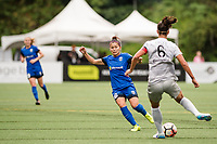 Seattle, WA - Sunday, August 13, 2017: Abby Erceg and Nahomi Kawasumi during a regular season National Women's Soccer League (NWSL) match between the Seattle Reign FC and the North Carolina Courage at Memorial Stadium.