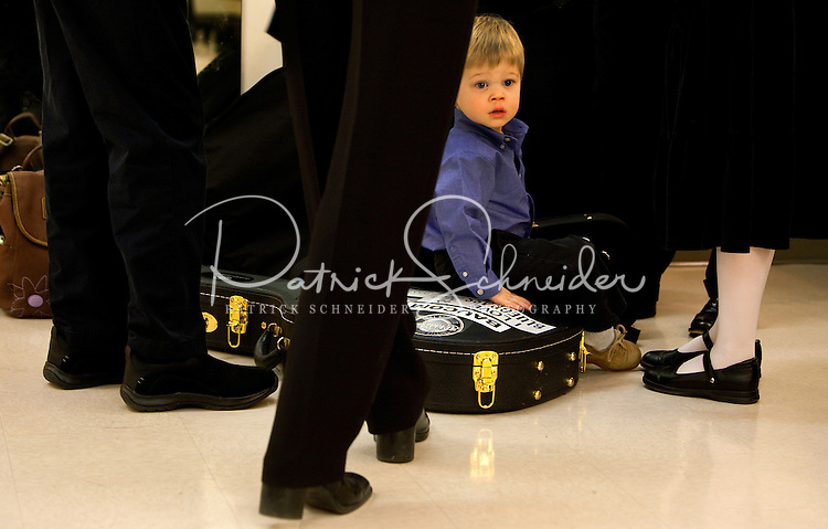 A budding musician waits while his family warms up behind stage during the 20th year of the Tosco Music Party, held at the Overcash Academic and Performing Arts Center Dale F. Halton Theater Central Piedmont Community College. The annual event, named after John Tosco, owner of the Tosco Music Studio, is designed to showcase professional and amateur musicians.