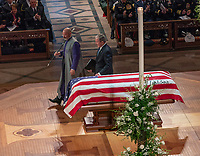 December 5, 2018 - Washington, DC, United States: Former President George W. Bush touches the casket of his father aftervproviding a eulogy at the state funeral service for his father, former President George W. Bush at the National Cathedral.  <br /> <br /> CAP/MPI/RS<br /> &copy;RS/MPI/Capital Pictures