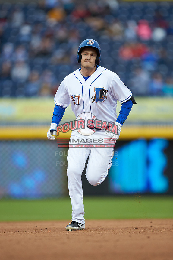 Jason Coats (17) of the Durham Bulls rounds the bases after hitting a home run against the Gwinnett Braves at Durham Bulls Athletic Park on April 20, 2019 in Durham, North Carolina. The Bulls defeated the Braves 11-3 in game one of a double-header. (Brian Westerholt/Four Seam Images)