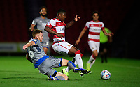 Doncaster Rovers' Niall Ennis is tackled by Lincoln City's Cian Bolger<br /> <br /> Photographer Chris Vaughan/CameraSport<br /> <br /> EFL Leasing.com Trophy - Northern Section - Group H - Doncaster Rovers v Lincoln City - Tuesday 3rd September 2019 - Keepmoat Stadium - Doncaster<br />  <br /> World Copyright © 2018 CameraSport. All rights reserved. 43 Linden Ave. Countesthorpe. Leicester. England. LE8 5PG - Tel: +44 (0) 116 277 4147 - admin@camerasport.com - www.camerasport.com