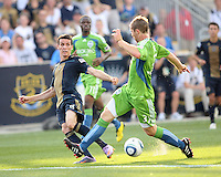 Sebastien Le Toux #9 of the Philadelphia Union slips the ball through the legs of Jeff Parke #31 of the Seattle Sounders FC during the first MLS match at PPL stadium in Chester, PA. on June 27 2010. Union won 3-12.