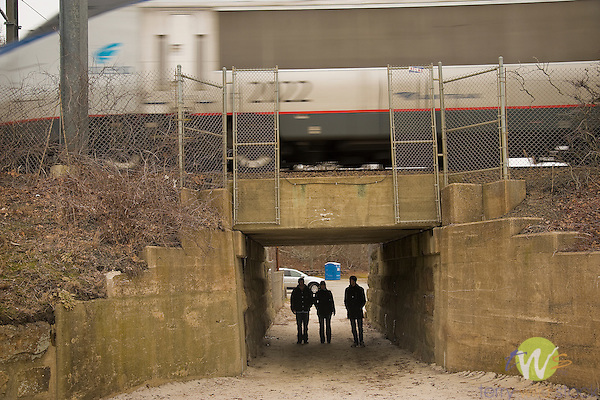 Below rail walkway with Amtrak Train passing over.