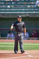 Umpire Kai Nakamura handles the calls on the bases during the game between the Idaho Falls Chukars and the Orem Owlz at Melaleuca Field on July 14, 2019 in Idaho Falls, Idaho. The Owlz defeated the Chukars 6-2. (Stephen Smith/Four Seam Images)