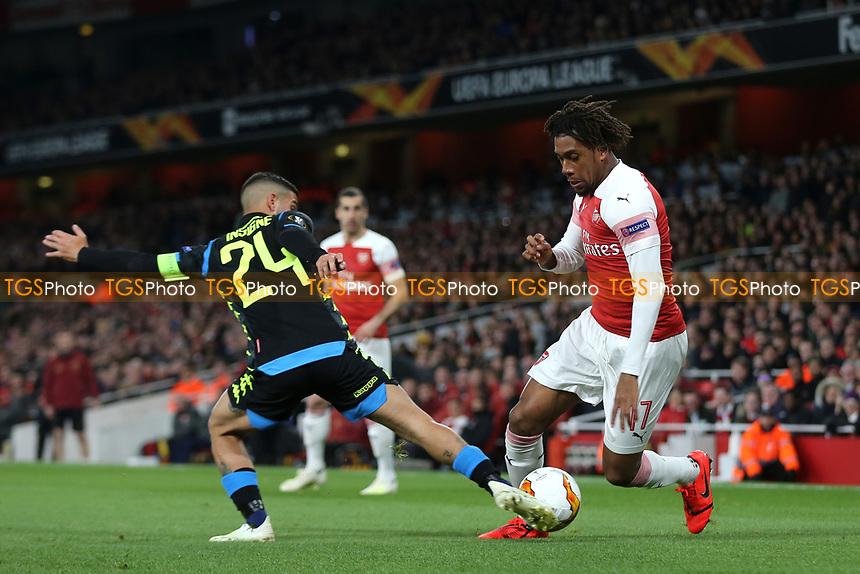 Alex Iwobi of Arsenal takes the ball past Napoli's Lorenzo Insigne during Arsenal vs Napoli, UEFA Europa League Football at the Emirates Stadium on 11th April 2019