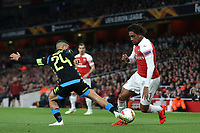 Alex Iwobi of Arsenal takes the ball past Napoli's Lorenzo Insigne during Arsenal vs Napoli, UEFA Europa League Football at the Emirates Stadium on 11th April 2019