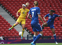 Women's Olympic Football match France v Sweden on 3.8.12...Sara Thunebro of Sweden and Corine Franco and Marie-Laure Delie of France, during the Women's Olympic Football match between France v Sweden at Hampden Park, Glasgow...............