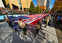 Photography coverage of the Novant Health Thanksgiving Day Parade - Mile of Smiles, Thanksgiving day morning on Tryon Street in Uptown Charlotte, North Carolina. Nearly 100,000 people came out to watch the parade march through Uptown Charlotte for the 71st time. <br /> <br /> Charlotte Photographer - PatrickSchneiderPhoto.com