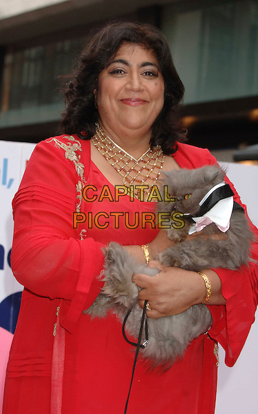 "GURINDER CHADHA & guests .At the UK Film Premiere of ""Angus, Thongs and Perfect Snogging"", Empire cinema, Leicester Square, London, England, July 16th 2008..half length red Indian dress gold necklace holding cat pet animal kitten .CAP/WIZ.©Wizard/Capital Pictures"