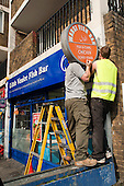Replacing shop signage on Westbourne parade, Harrow Road.