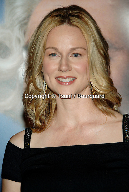Laura Linney arriving at MAN OF THE YEAR premiere at the Chinese Theatre  In Los Angeles.<br /> <br /> headshot<br /> black dress