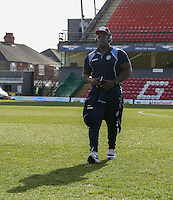 Adebayo Akinfenwa of Wycombe Wanderers looks over the pitch on arrival before the Sky Bet League 2 match between Grimsby Town and Wycombe Wanderers at Blundell Park, Cleethorpes, England on 4 March 2017. Photo by Andy Rowland / PRiME Media Images.