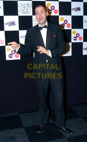 JOHNNY VAUGHAN.At the Capital Rocks! Party, .Battersea Park Events Arena, London, .England, December 12th 2006..full length tuxedo suit bow tie hands.CAP/CAN.©Can Nguyen/Capital Pictures