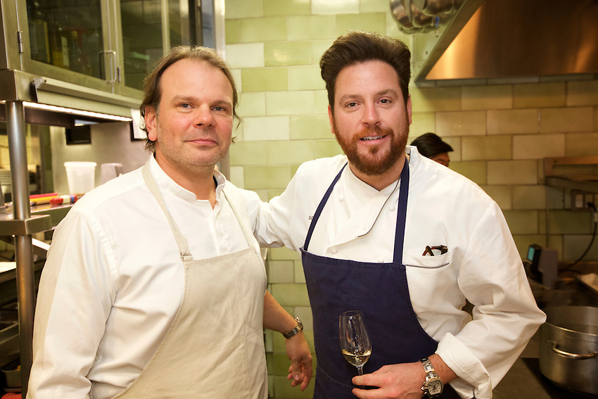 New York, NY - March 13, 2016: Chefs Frank Falcinelli and Scott Conant in the kitchen at Restaurant Daniel at Black Tie and Blue Jeans, the annual Sunday Supper fundraiser, benefiting Citymeals on Wheels.<br /> <br /> CREDIT: Clay Williams for Edible Manhattan.<br /> <br /> &copy; Clay Williams / claywilliamsphoto.com