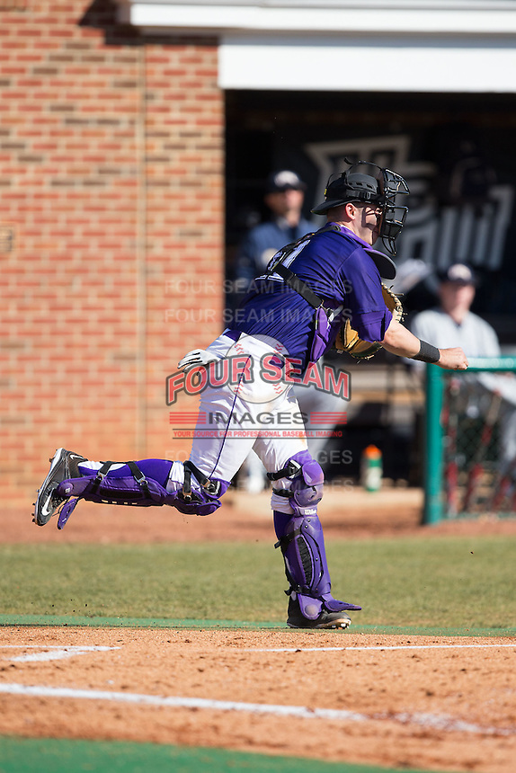 High Point Panthers catcher Josh Spano (21) makes a throw to second base against the UNCG Spartans at Willard Stadium on February 14, 2015 in High Point, North Carolina.  The Panthers defeated the Spartans 12-2.  (Brian Westerholt/Four Seam Images)