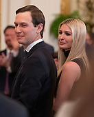 Senior Advisor Jared Kushner, left, and First Daughter and Advisor to the President Ivanka Trump, right, stand as United States President Donald J. Trump makes remarks during the 2019 Prison Reform Summit and First Step Act Celebration in the East Room of the White House in Washington, DC on Monday, April 1, 2019.<br /> Credit: Ron Sachs / CNP