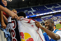 Shaun Wright Philips (8) of Manchester City F. C. signs a New York Red Bulls jersey before the game. Sporting Clube de Portugal defeated Manchester City F. C. 2-0 during a Barclays New York Challenge match at Red Bull Arena in Harrison, NJ, on July 23, 2010.