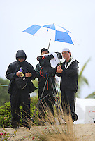151206  Japan's Jupiter Golf Network TV crew soaked on the 3rd green during Sunday's Final Round of the Hero World Challenge at The Albany Golf Club, in New Providence, Nassau, Bahamas.(photo credit : kenneth e. dennis/kendennisphoto.com)
