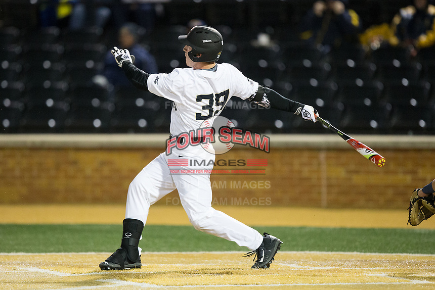 Ben Breazeale (39) of the Wake Forest Demon Deacons follows through on his swing against the Kent State Golden Flashes in game two of a double-header at David F. Couch Ballpark on March 4, 2017 in Winston-Salem, North Carolina.  The Demon Deacons defeated the Golden Flashes 5-0.  (Brian Westerholt/Four Seam Images)