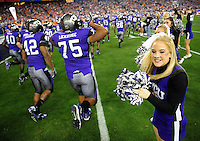 Jan. 4, 2010; Glendale, AZ, USA; TCU Horned Frogs players enter the field prior to the game against the Boise State Broncos in the 2010 Fiesta Bowl at University of Phoenix Stadium. Boise State defeated TCU 17-10. Mandatory Credit: Mark J. Rebilas-