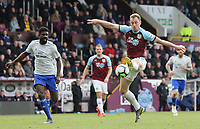 Burnley's Ashley Barnes controls under pressure from Cardiff City's Bruno Ecuele Manga<br /> <br /> Photographer Rich Linley/CameraSport<br /> <br /> The Premier League - Saturday 13th April 2019 - Burnley v Cardiff City - Turf Moor - Burnley<br /> <br /> World Copyright © 2019 CameraSport. All rights reserved. 43 Linden Ave. Countesthorpe. Leicester. England. LE8 5PG - Tel: +44 (0) 116 277 4147 - admin@camerasport.com - www.camerasport.com