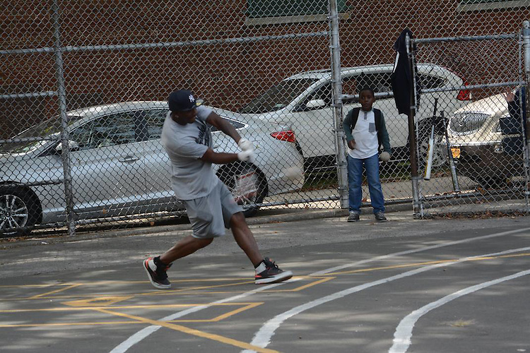 Raj Rogers contacts for a three run home run for team Breukelen in the Police Athletic League Softball Tournament  against the 69th Police Precinct in Canarsie,Brooklyn on September 26,2015