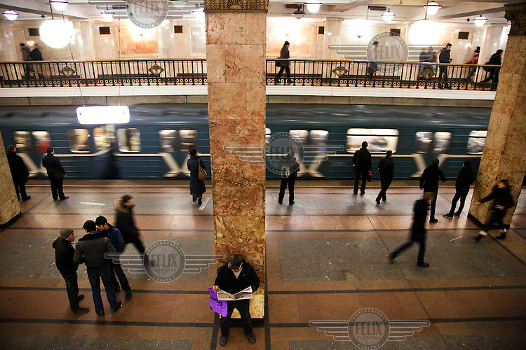 People in one of Moscow's metro stations, famous for their magnificent design.