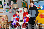 Visiting Santa in the Cahersiveen Credit Union on Saturday were Niall, Brian & Cathal O'Driscoll.