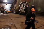 A worker, breathing through a breathing aid, walked through the smelting section of the copper factory of the company Norilsk Nickel in the city of Norilsk, a vital metallurgical industrial city in Russia's Artic north. June 15, 2007
