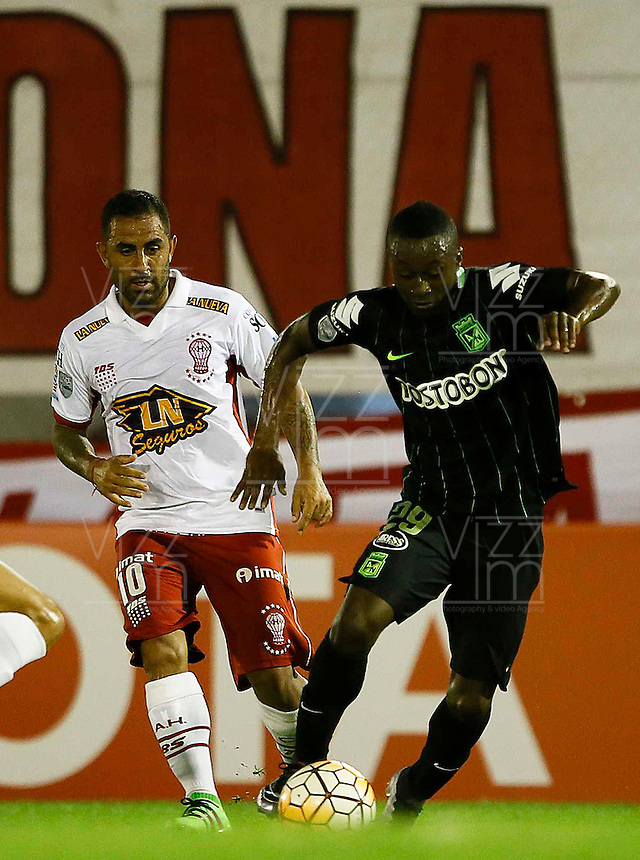 BUENOS AIRES - ARGENTINA - 24-02-2016: Daniel Montenegro (Izq.) jugador de Huracan de Argentina disputa el balon con Marlos Moreno (Der.) jugador de Atletico Nacional de Colombia durante partido de la Primera Fecha del Grupo 4 por la Segunda Fase, entre Huracan y Atletico Nacional de la Copa Bridgestone Libertadores 2016 en el Estadio Tomas A Duco, de la ciudad de Buenos Aires. / Daniel Montenegro (L) player of Huracan of Argentina vies for the ball with con Marlos Moreno (R) player Atletico Nacional of Colombia, during a match for the first date of the Group 4 for the second phase between Huracan and Atletico Nacional of Colombia for the Bridgestone Libertadores Cup 2016, in the Tomas A Duco, Stadium, in Buenos Aires city. Photo: Photogamma / Javier Garcia Martino / VizzorImage / Cont