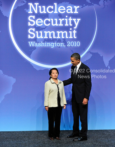 United States President Barack Obama welcomes President Gloria Macapagal-Arroyo of the Philippines to  the Nuclear Security Summit at the Washington Convention Center, Monday, April 12, 2010 in Washington, DC. .Credit: Ron Sachs / Pool via CNP