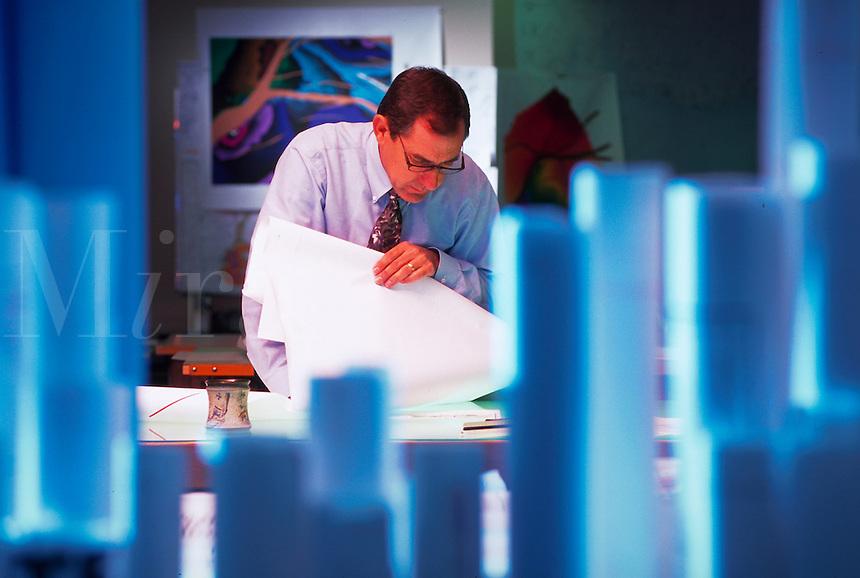 Petroleum engineer looking at seismic maps